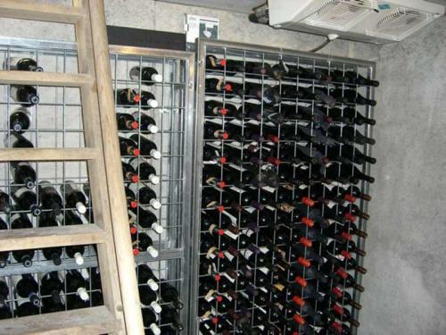 Galvanised wine racks in a cool room