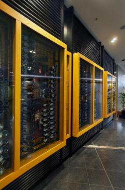 Powder Coated Connoisseur Wine Racks behind Glass